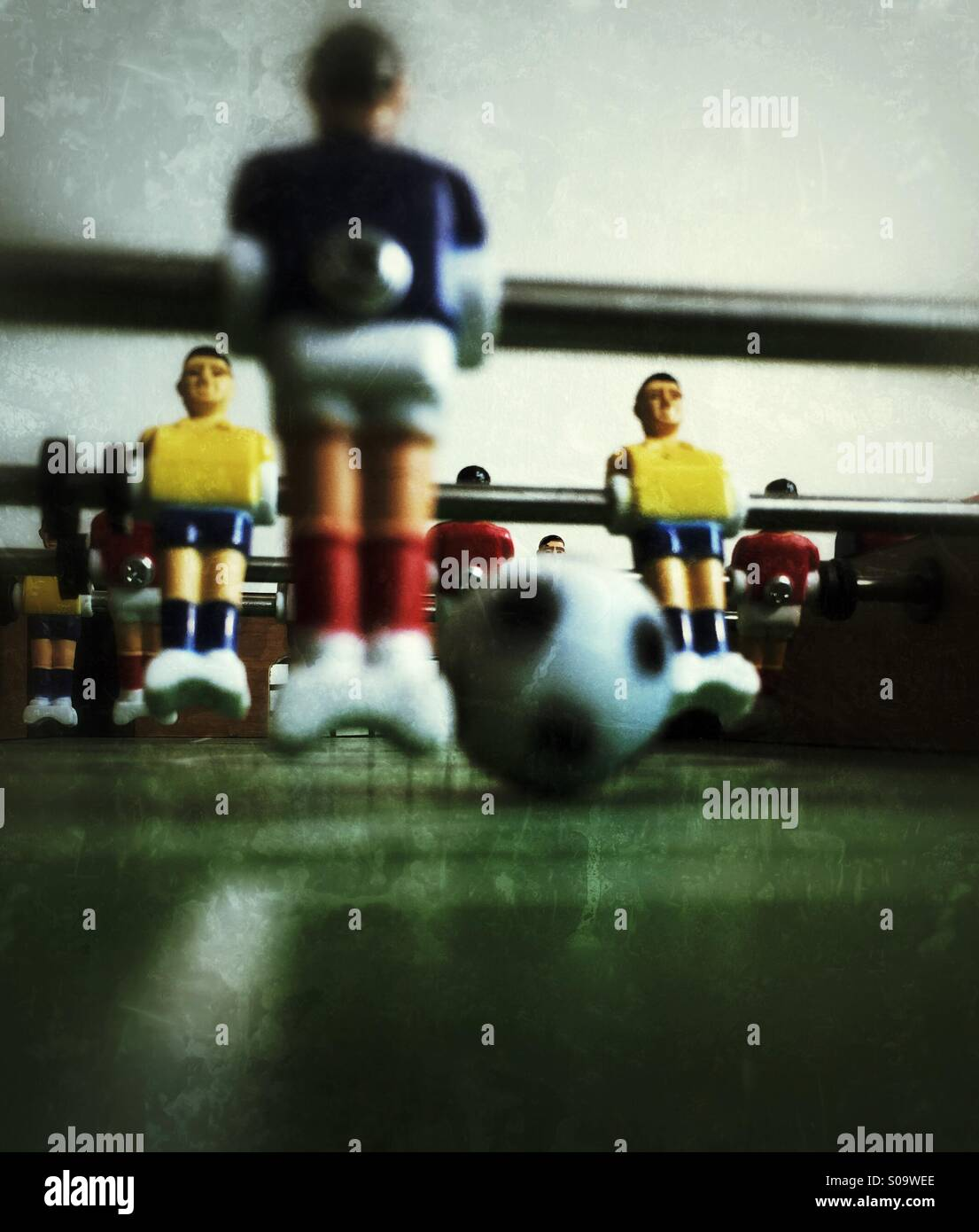 Table football/soccer game photographed from game field perspective. - Stock Image