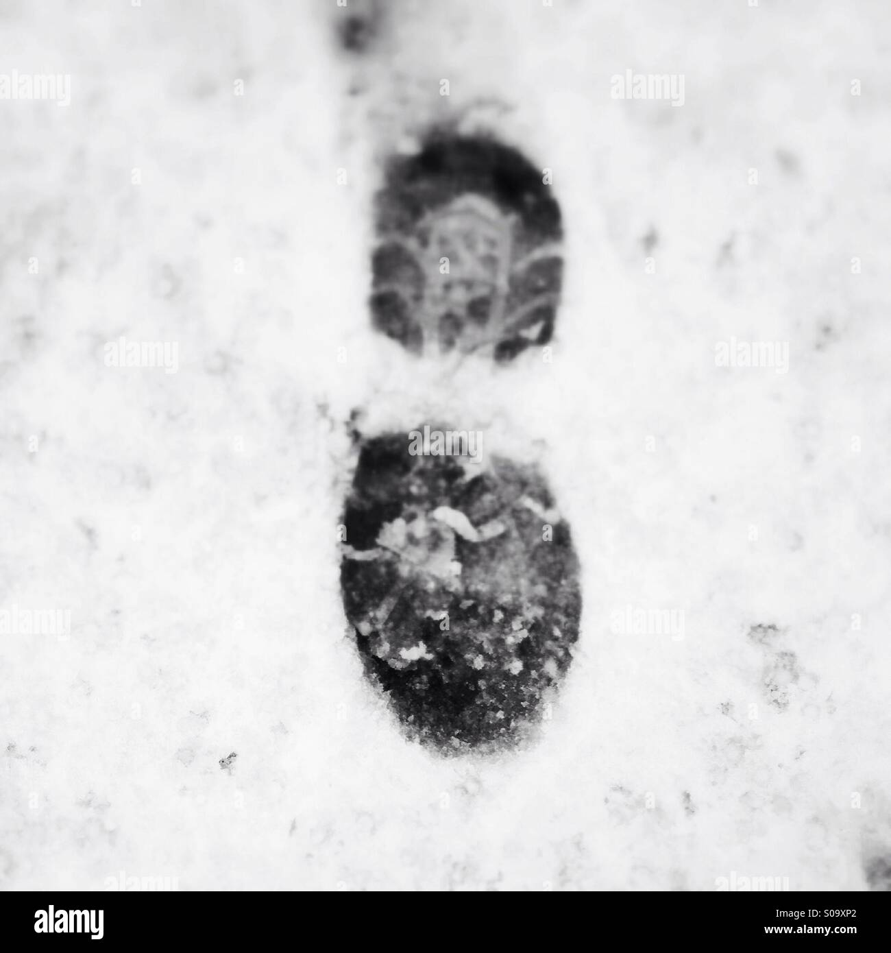Footprint in the snow - Stock Image