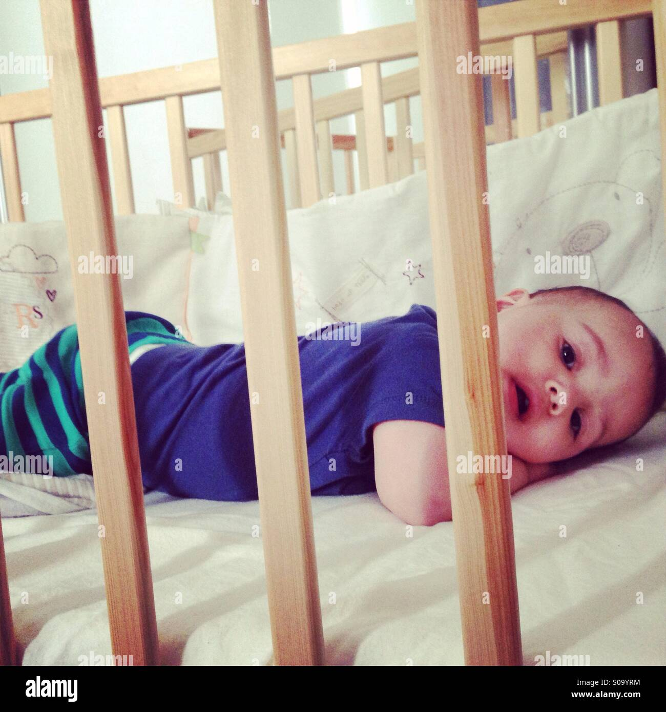 Toddler in cot - Stock Image