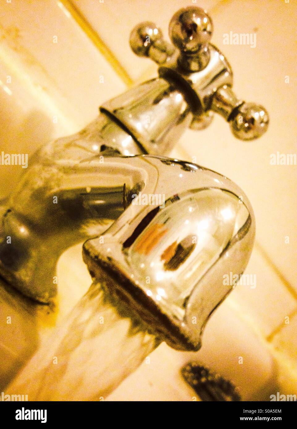 Running water tap - Stock Image