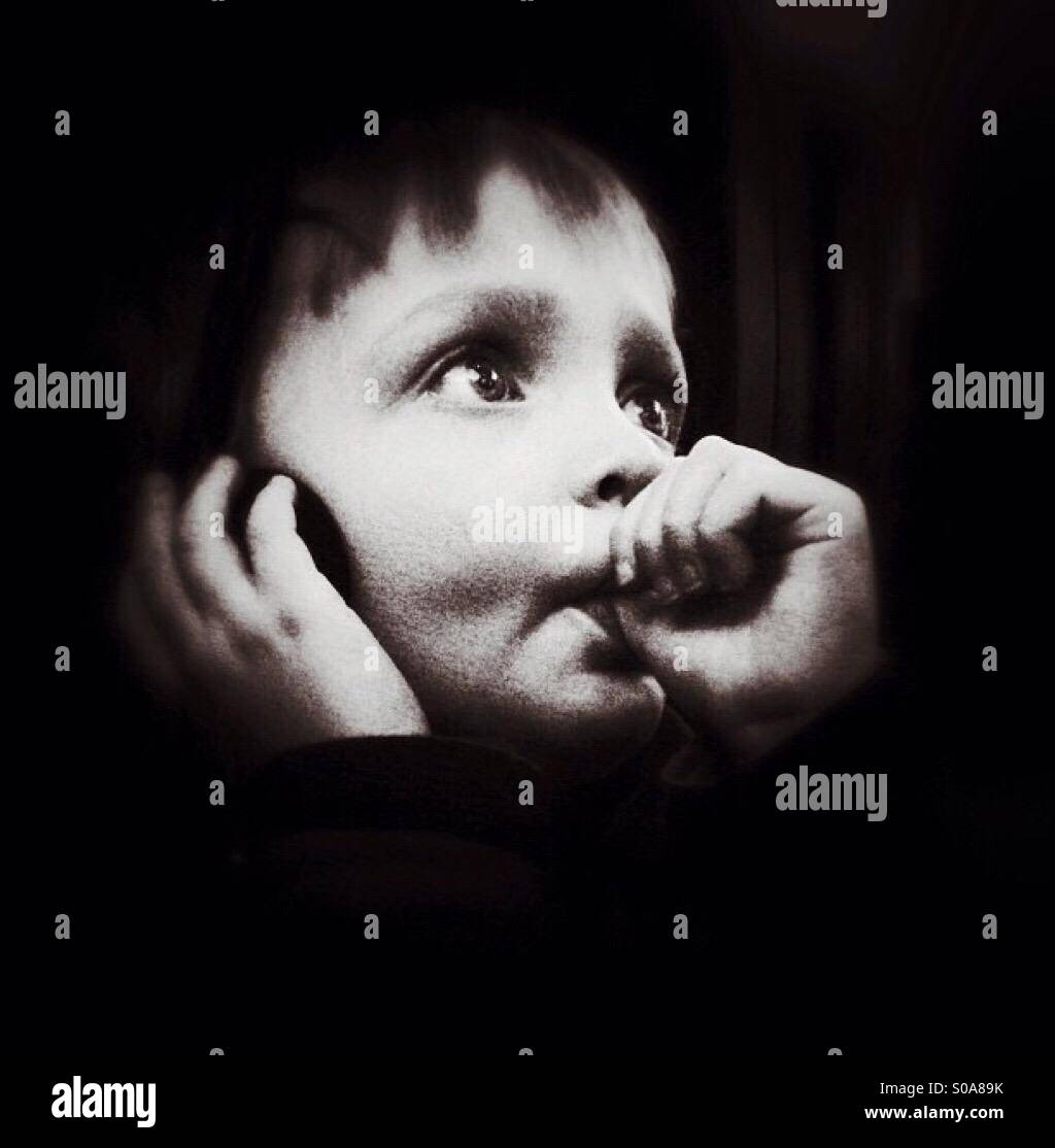Boy sucking his thumb - Stock Image