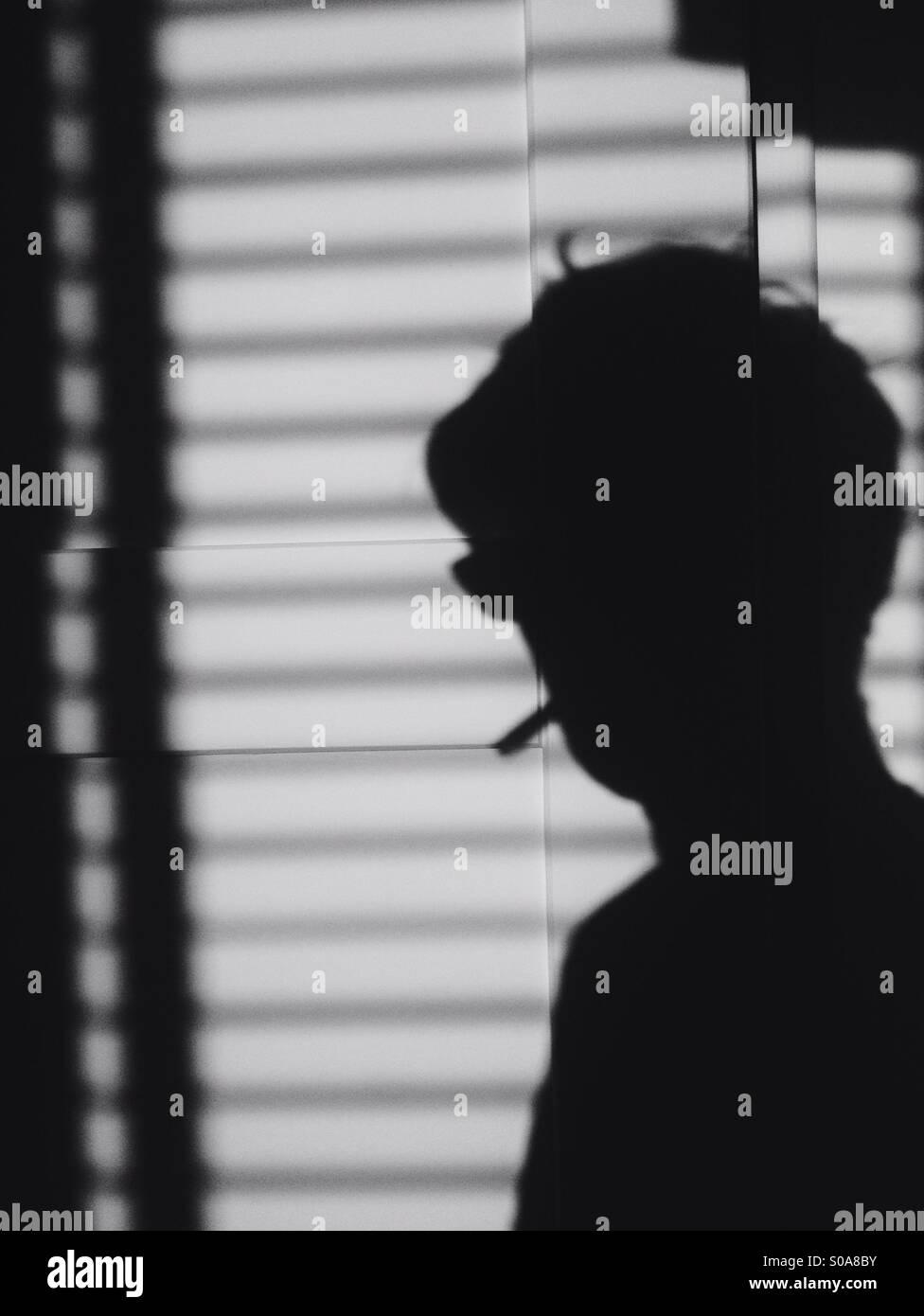 Smoking man silhouette - Stock Image
