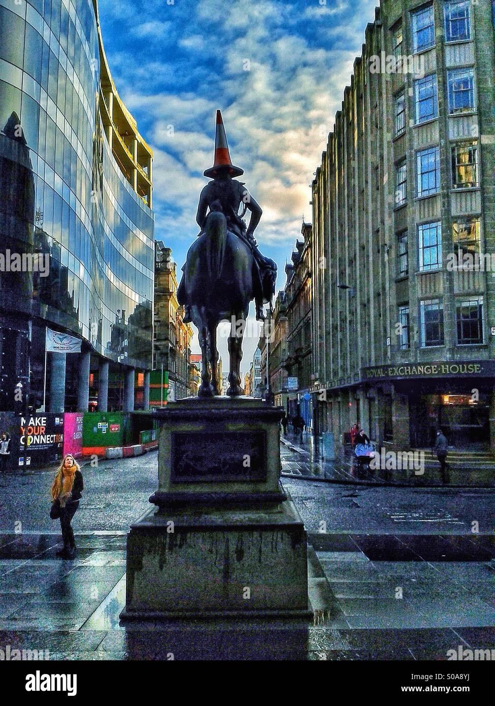 Glasgow's Duke Of Wellington Statue wearing a Traffic Cone - Stock Image