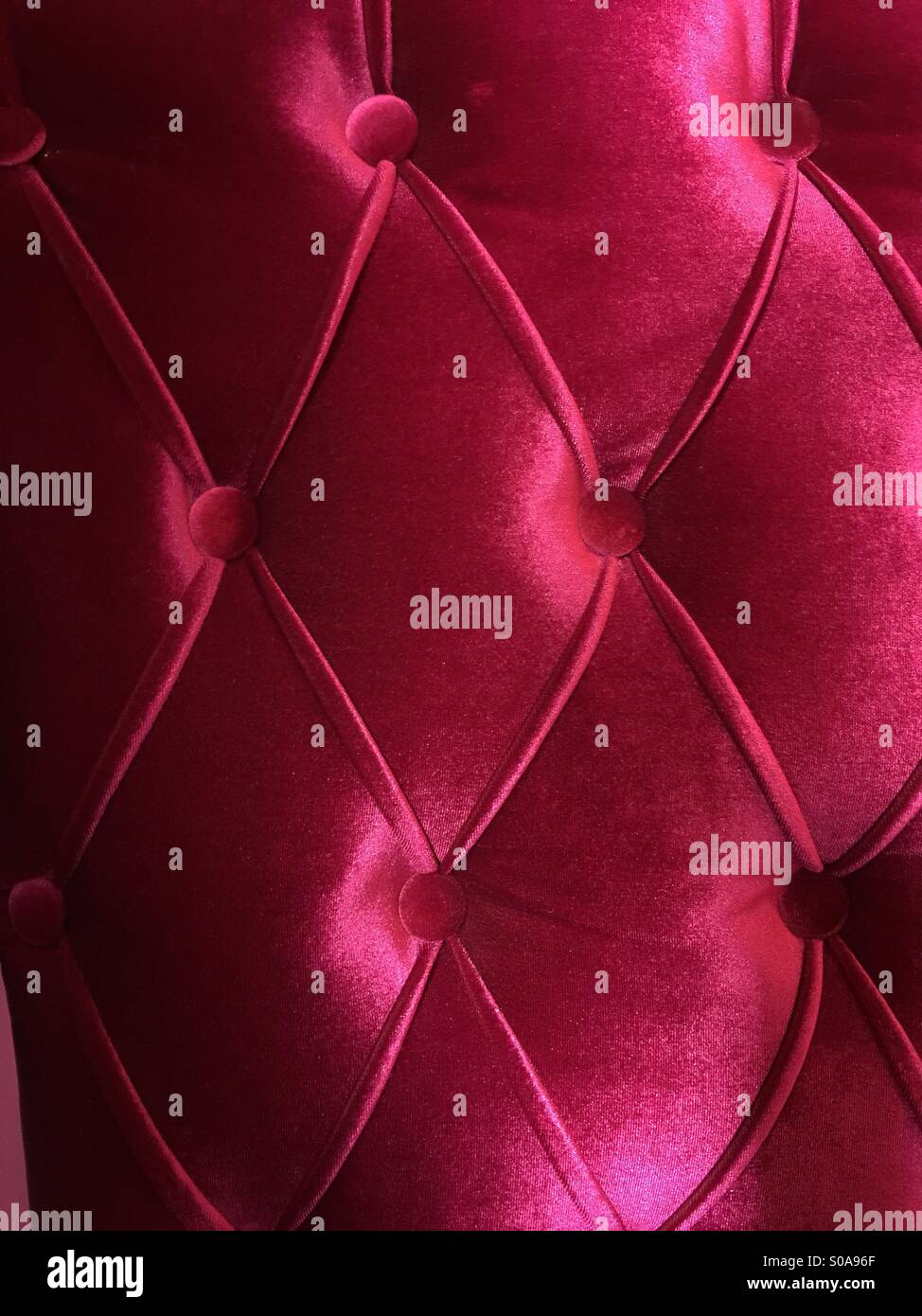 Upholstered Fabric red pattern - Stock Image
