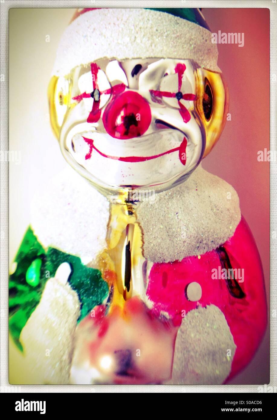 A shiny metal clown figurine. - Stock Image