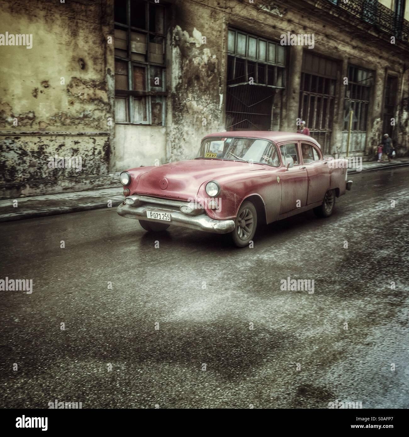 Red classic Cuban automobile in Habana Vieja. Havana, Cuba - Stock Image
