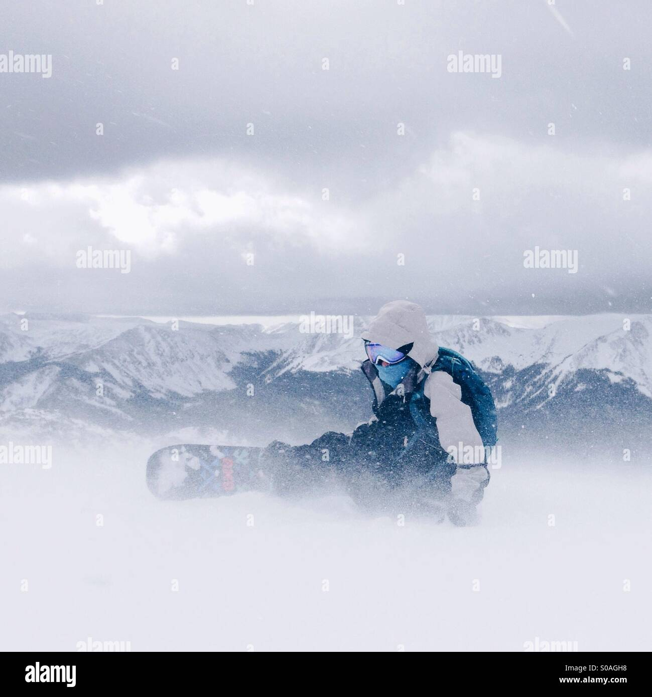 Windy mountain snowboarder - Stock Image