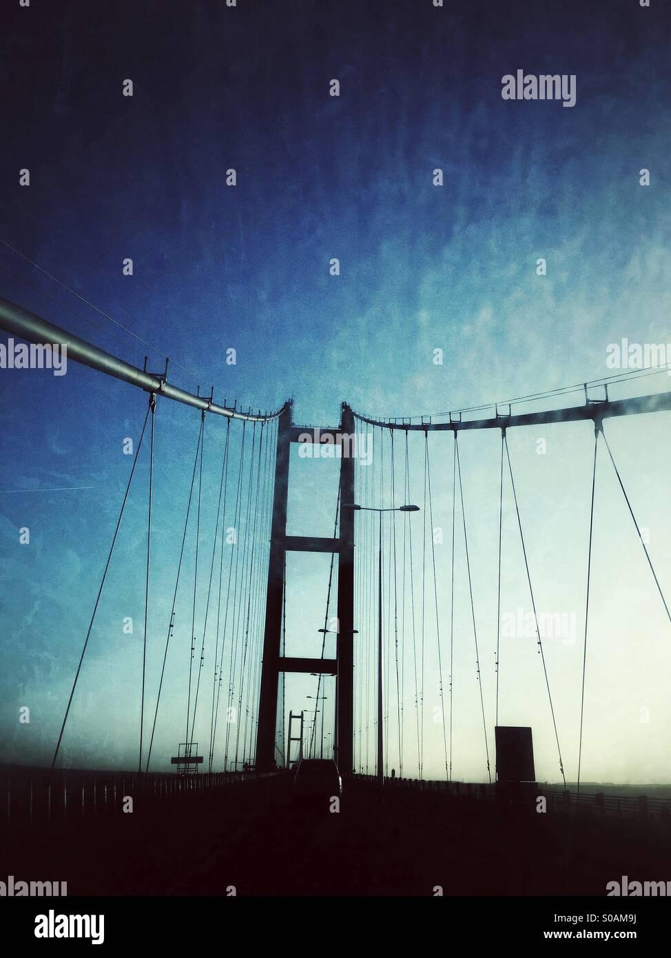 Humber Bridge single span suspension bridge at twilight, England UK - Stock Image