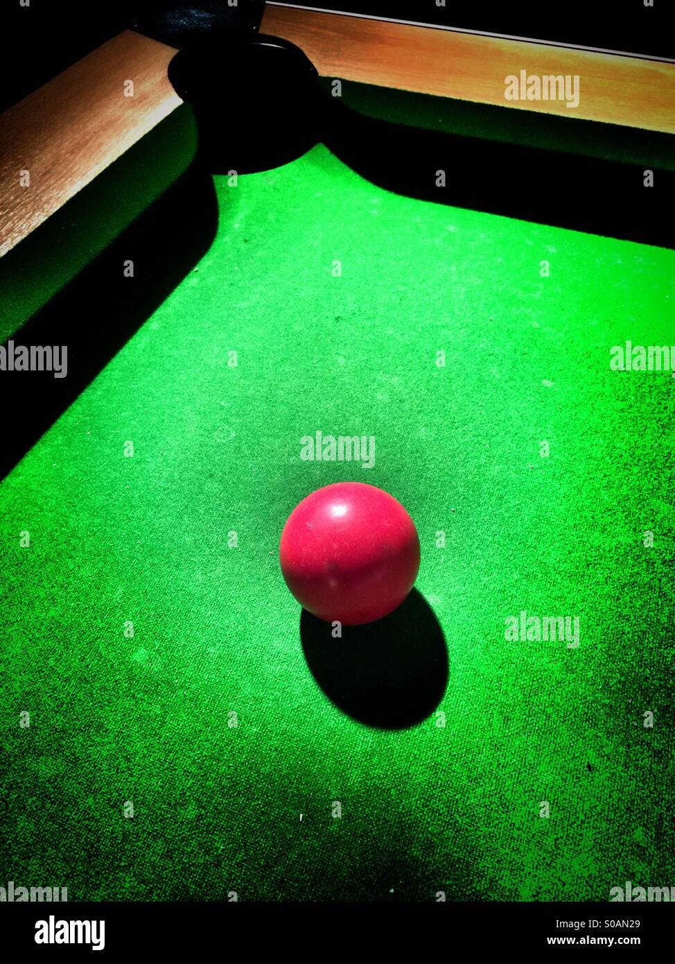 Snooker red ball going towards the hole - Stock Image