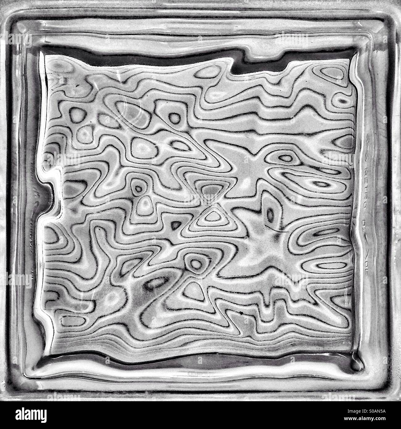 Abstract of light pattern through a warped-glass block. - Stock Image