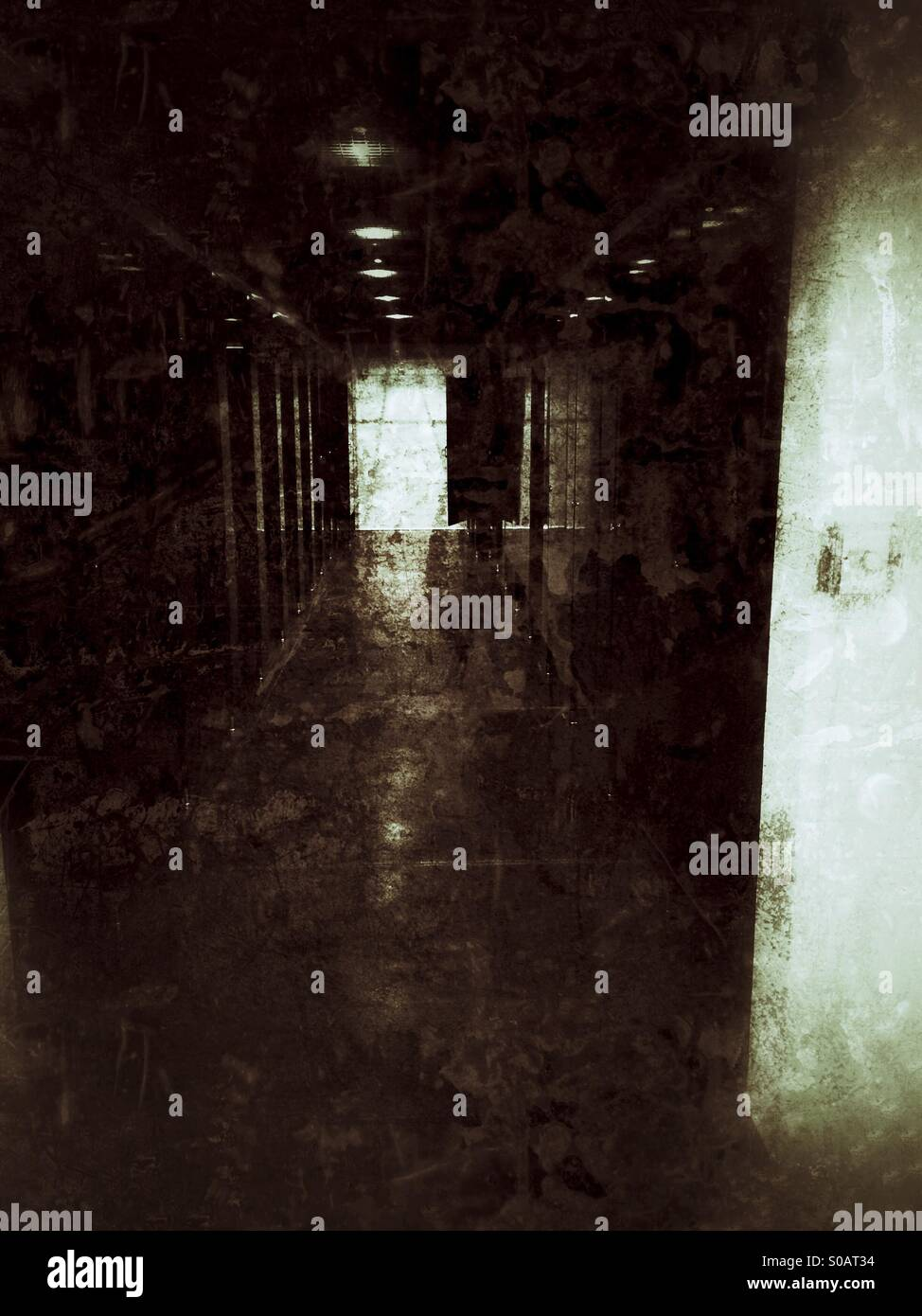 Unknown in a dark hallway - Stock Image