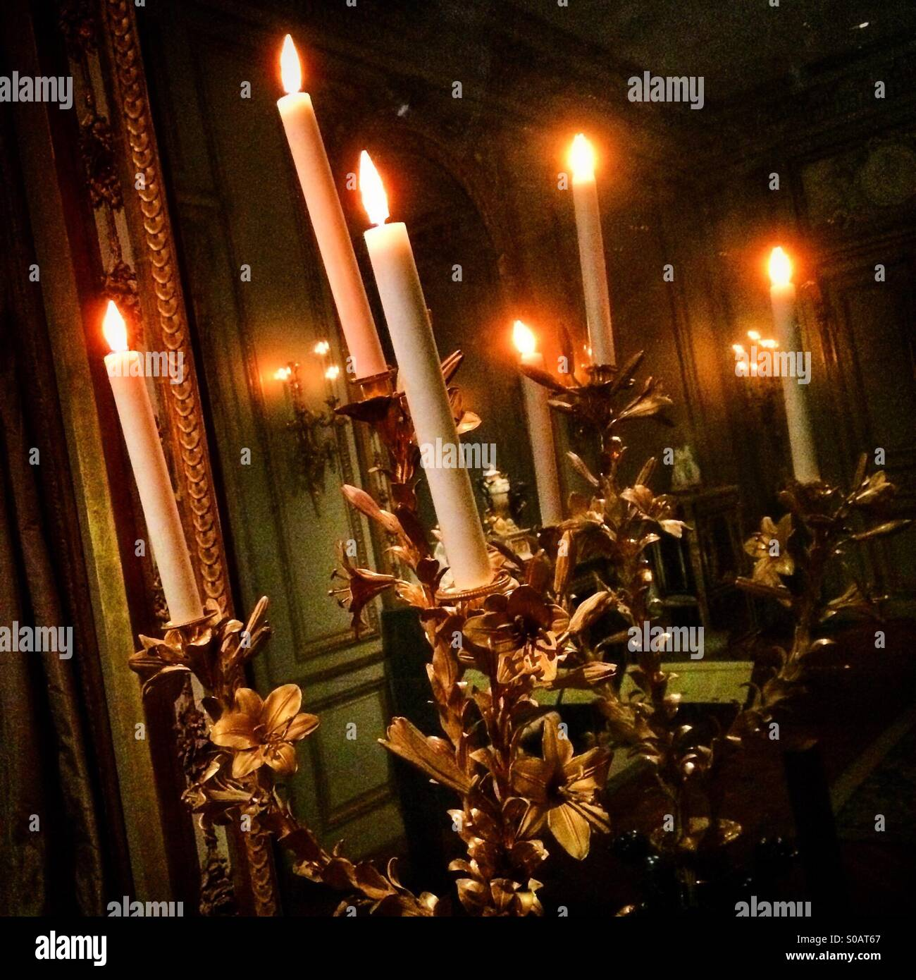 Candles in golden light - Stock Image