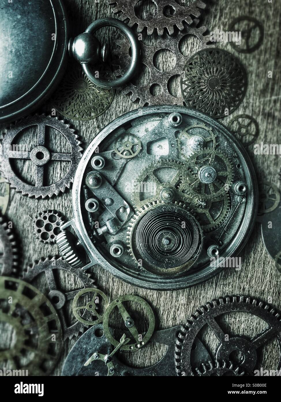 Pocket watches and gears. - Stock Image