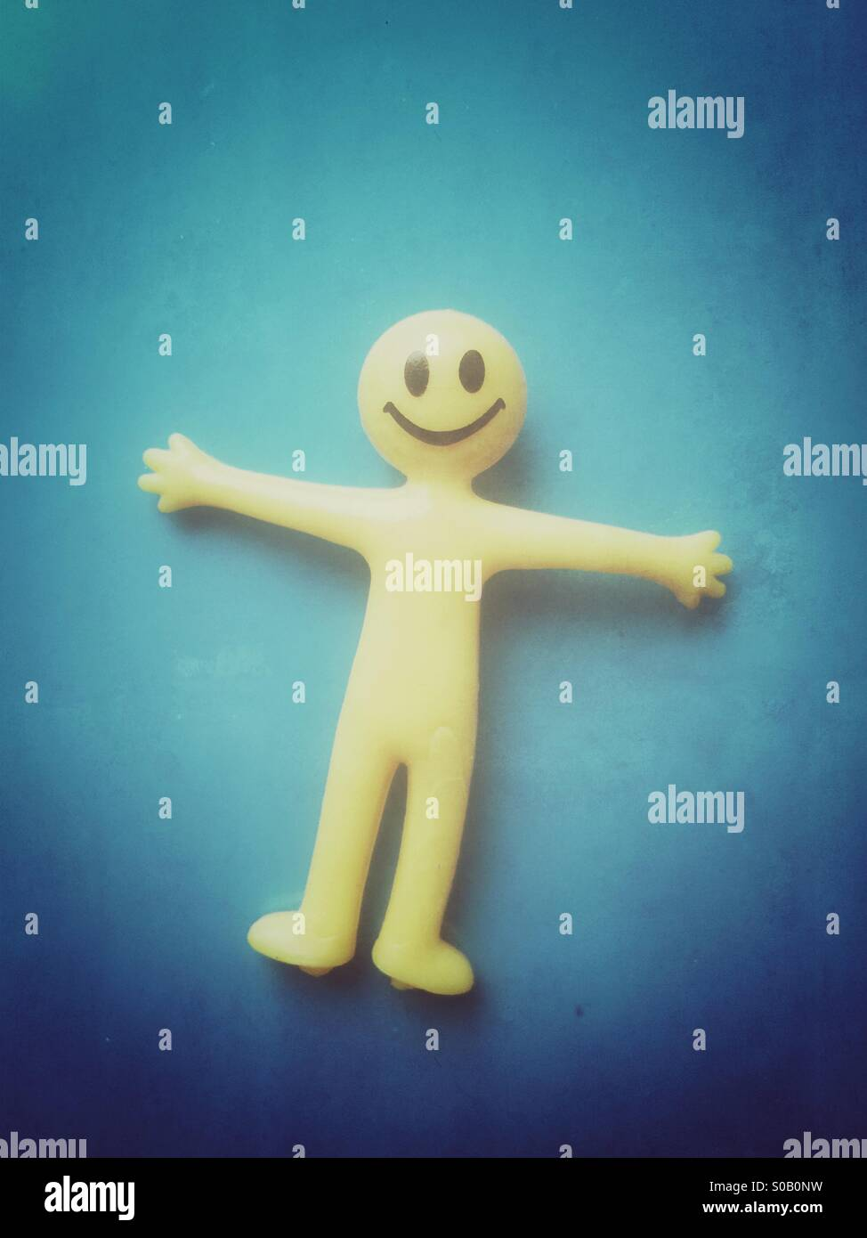Smiley face rubber toy - Stock Image