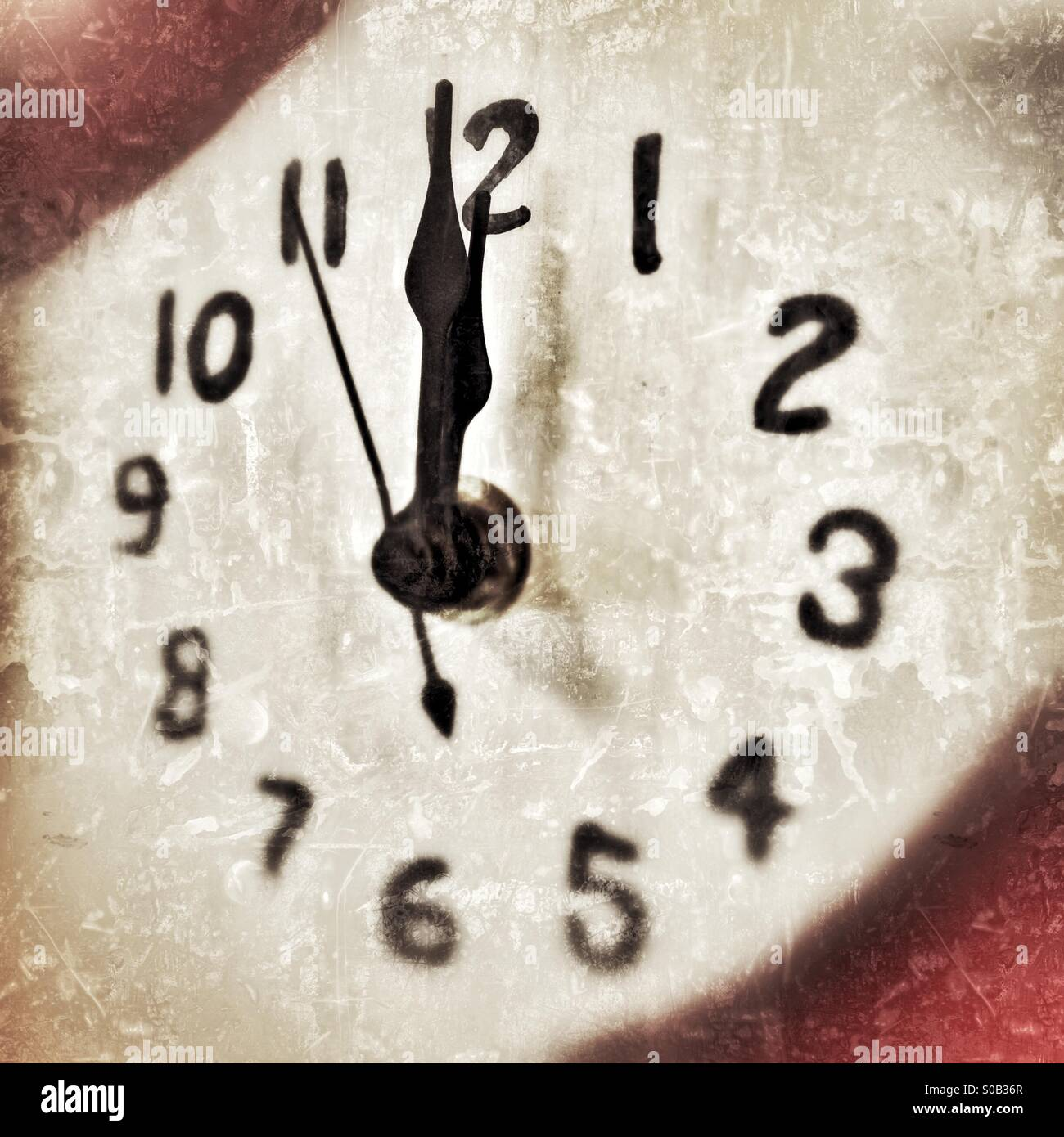 Numbers On Clock Face With The Focus Showing The Time Seconds Before Twelve O'Clock Midnight - Stock Image