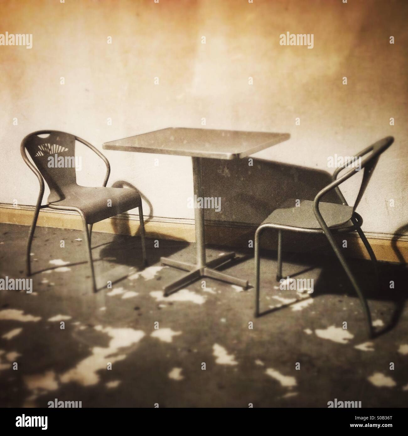 Two Empty Chairs And A Table In Vintage Retro Sepia Tones - Stock Image
