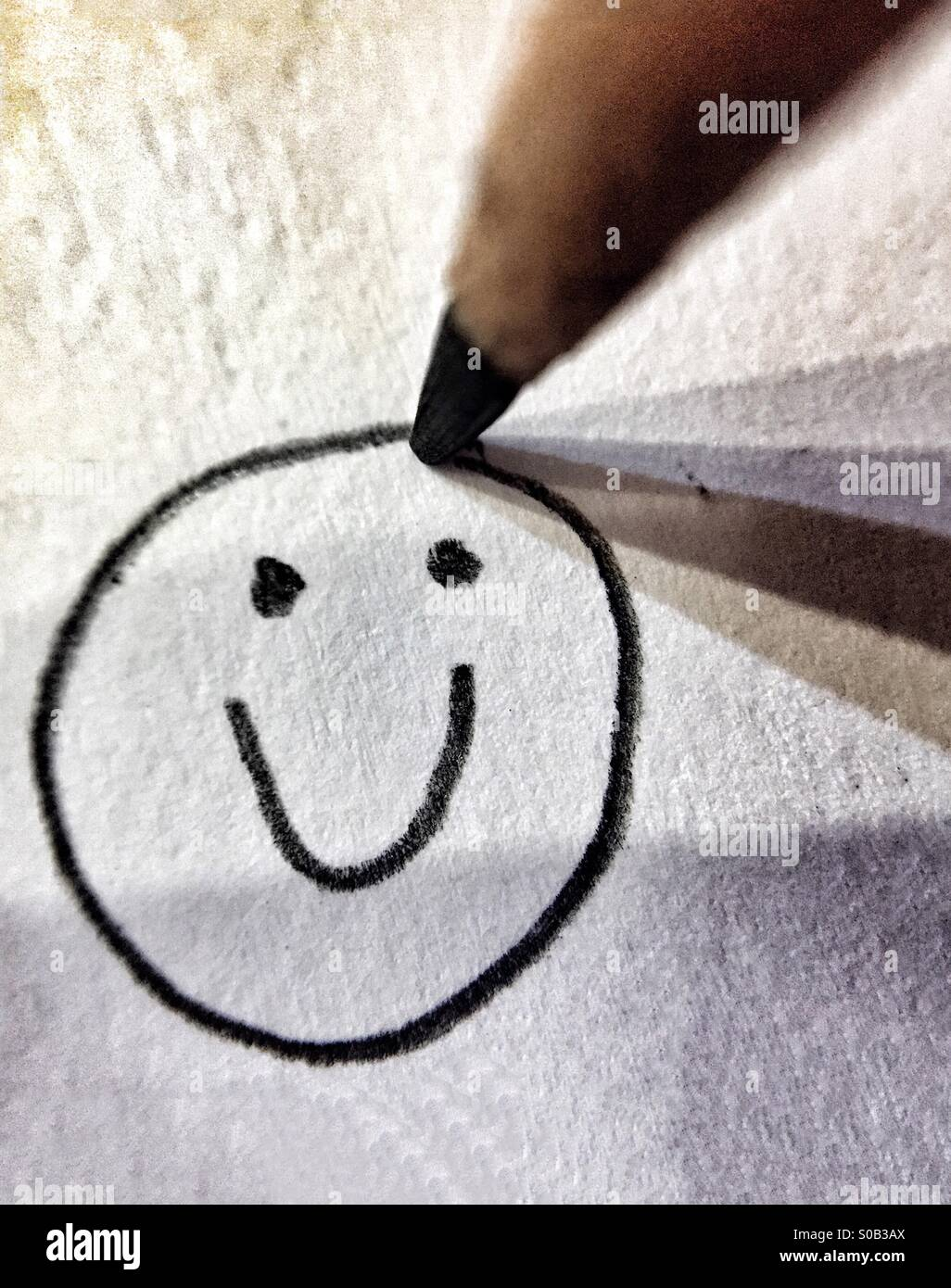 Pencil Drawing Of A Happy, Smiling Face - Stock Image