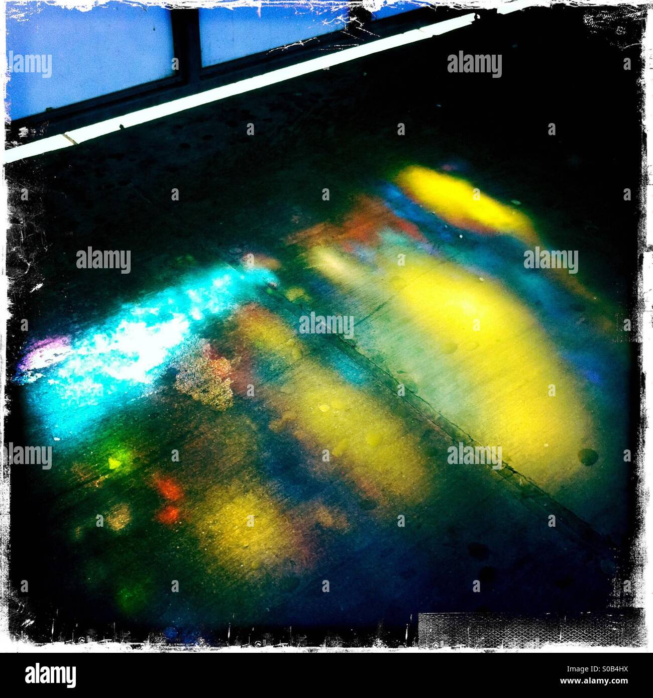 Rainbow colors reflected on a subway platform in Brooklyn. - Stock Image