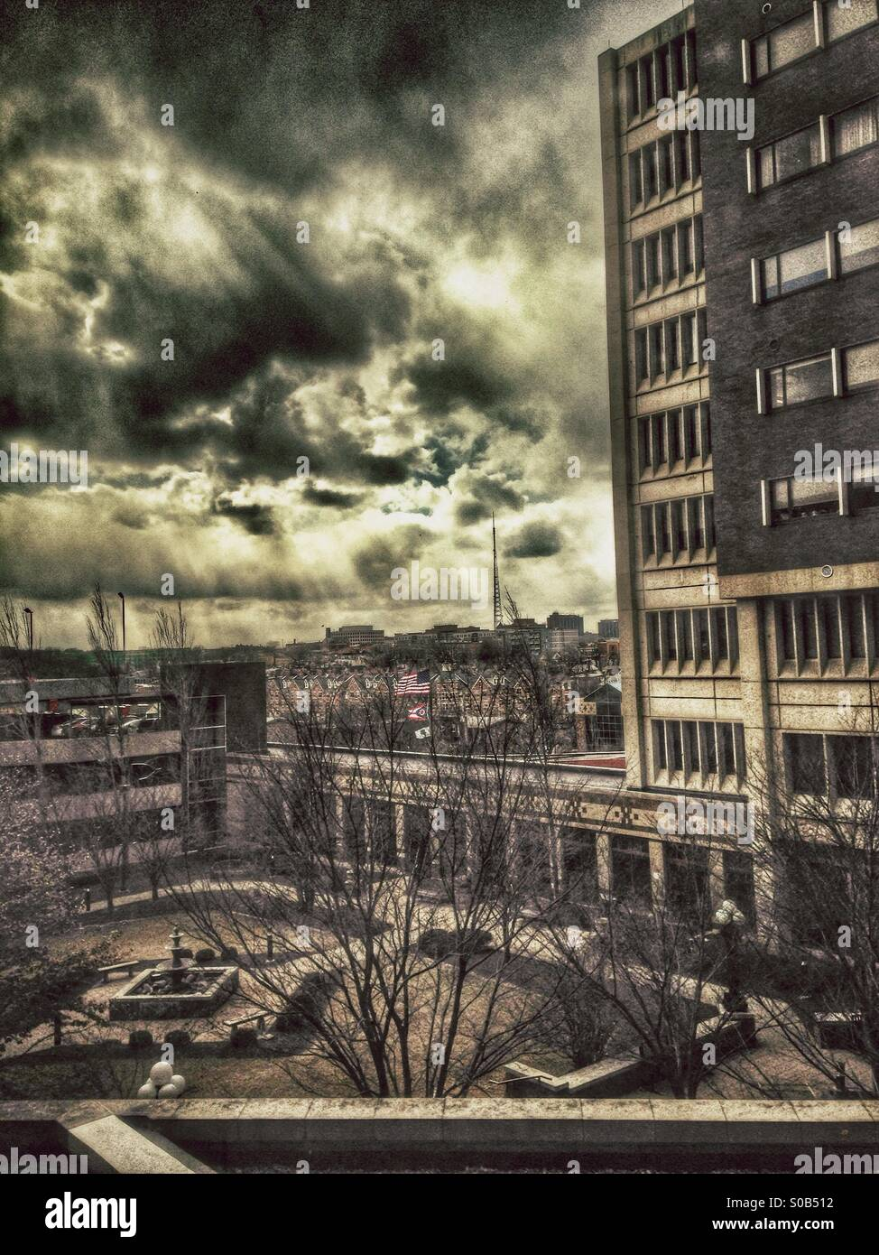 An approaching snow shower through a hospital window (hdr,dramatic,monochromatic). - Stock Image