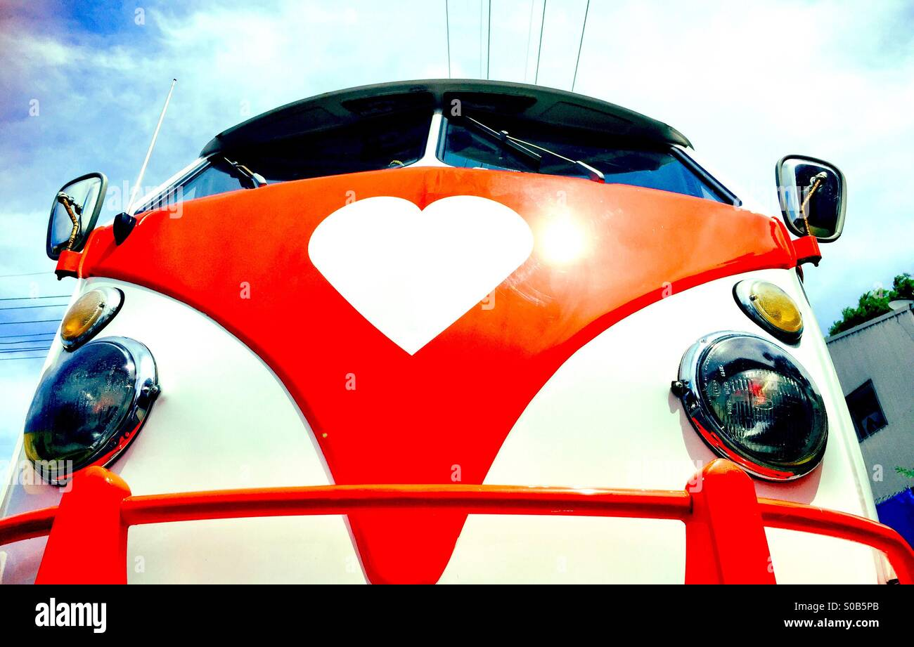 A vintage VW Campervan with a heart logo - Stock Image