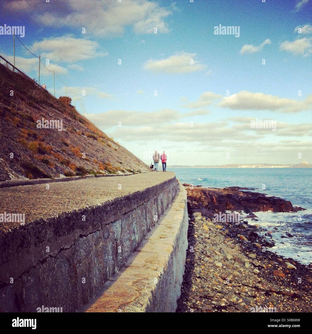 Strolling by the sea Stock Photo