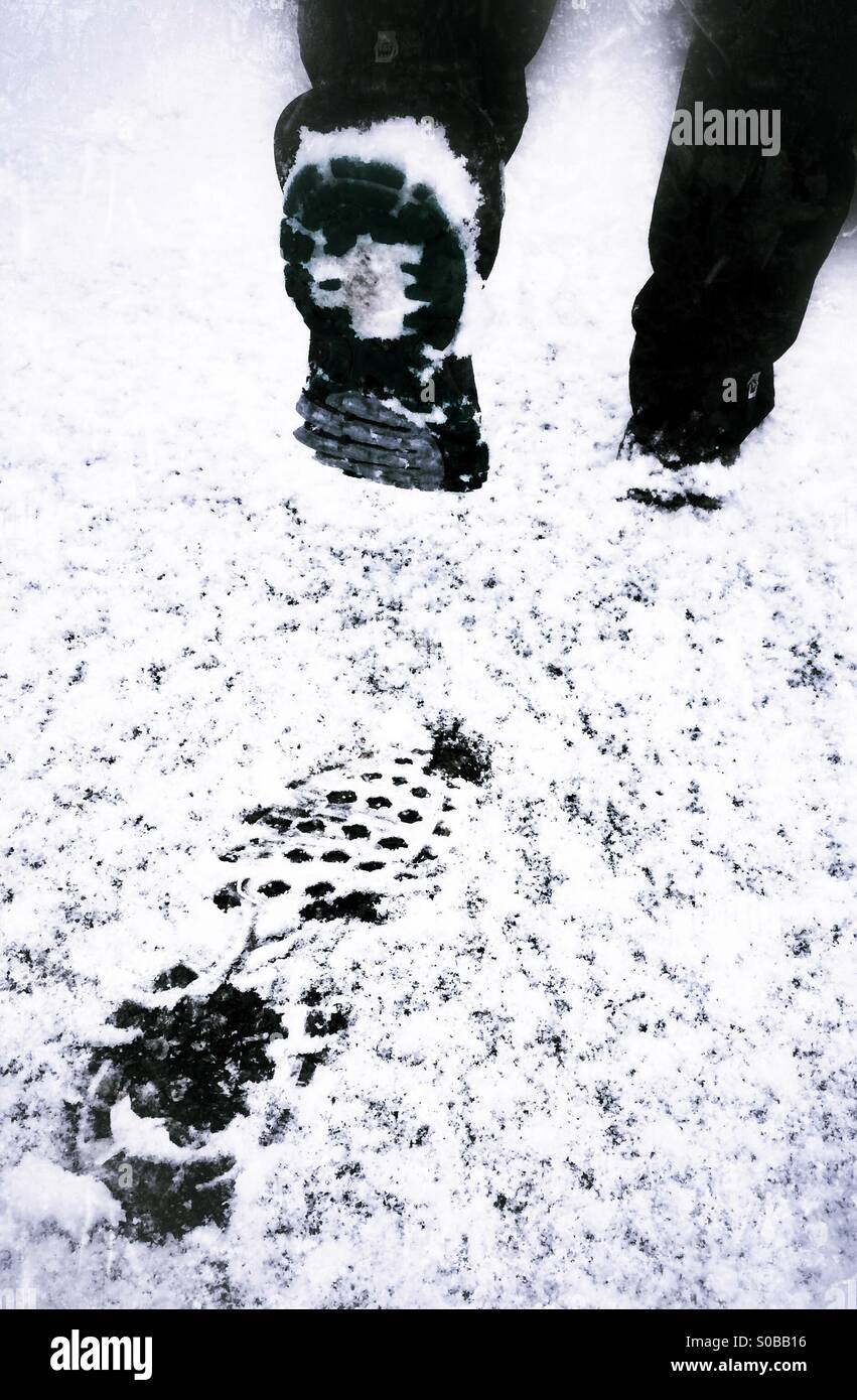 Footsteps in the snow. Stock Photo
