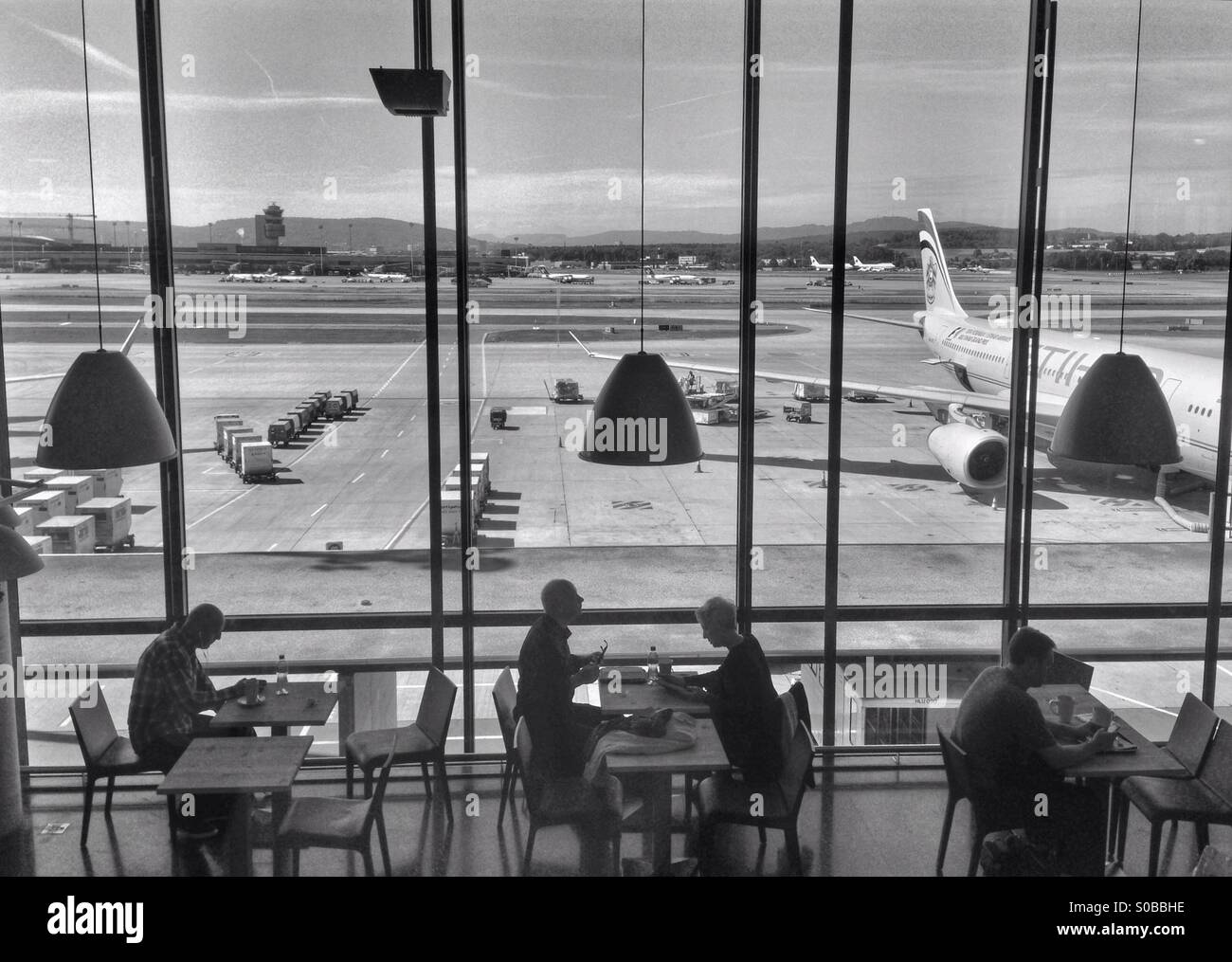 Travelers at Zurich airport - Stock Image