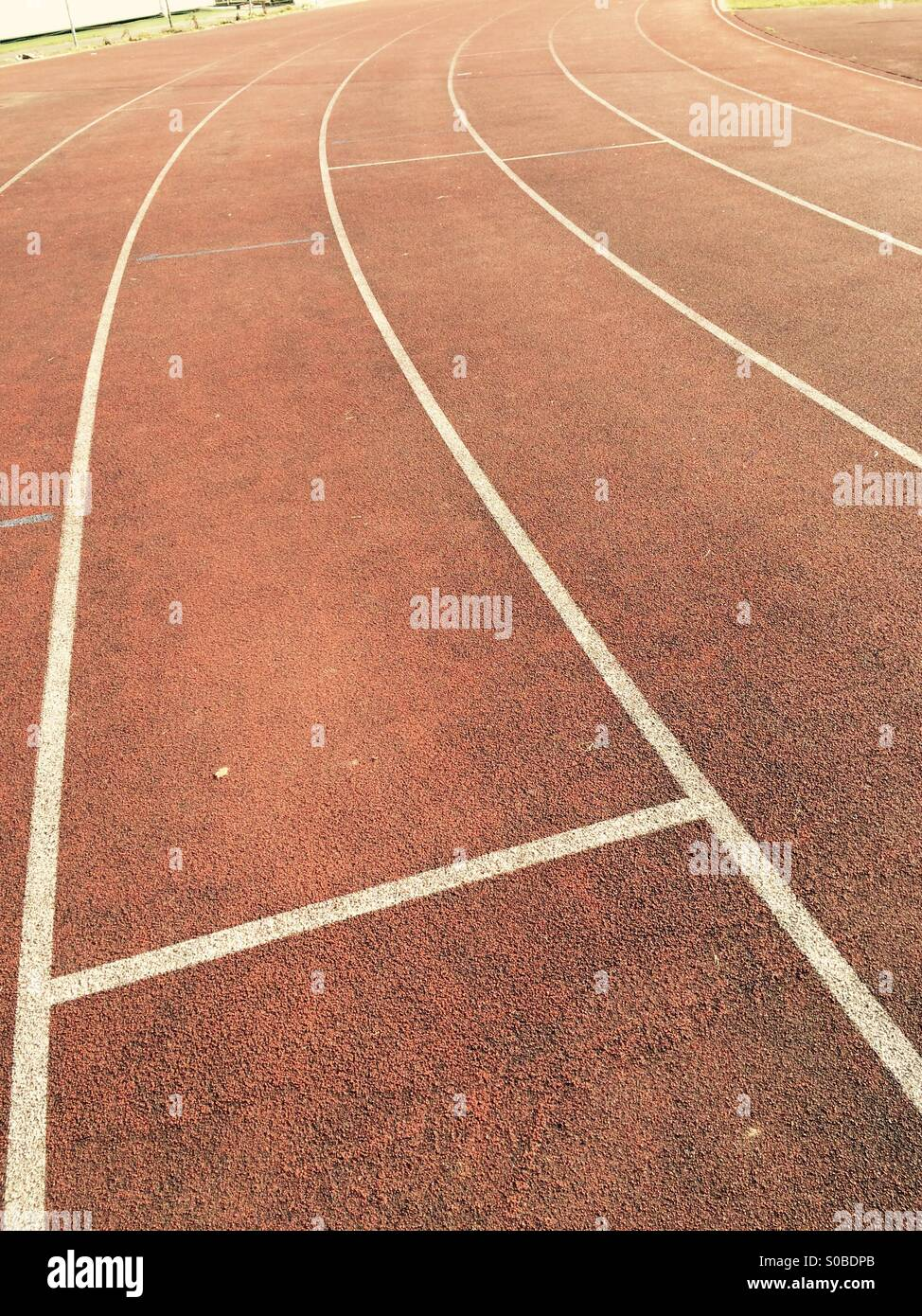 Lines on an athletics track - Stock Image