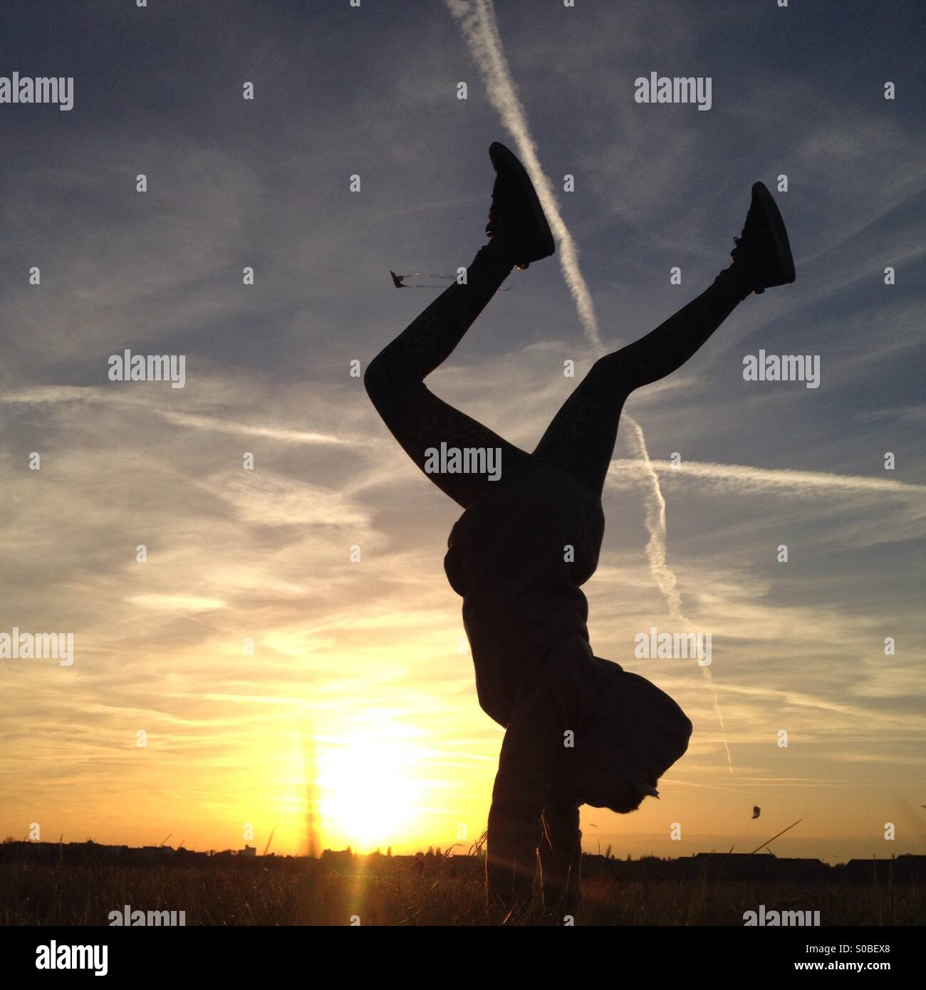 Handstand on Tempelhofer Feld - Stock Image