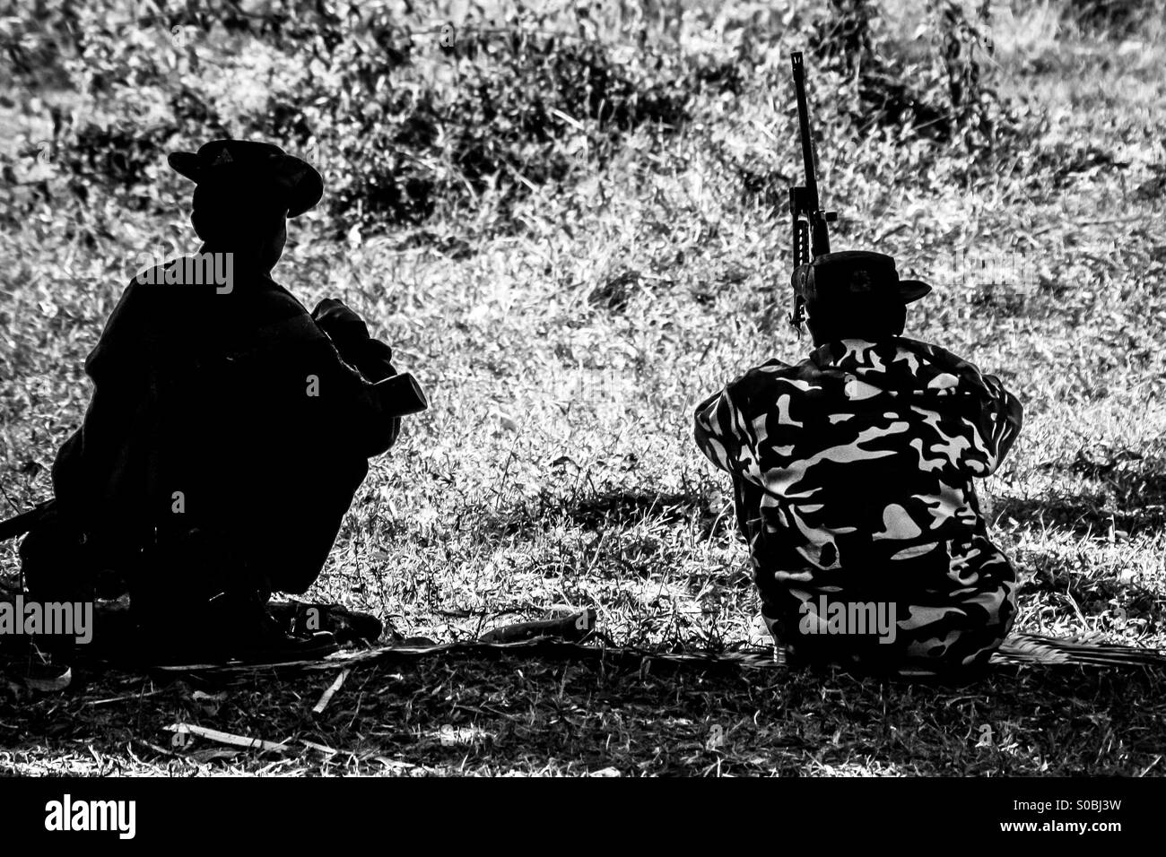 Two soldiers on watch in the Chin State, Myanmar - Stock Image