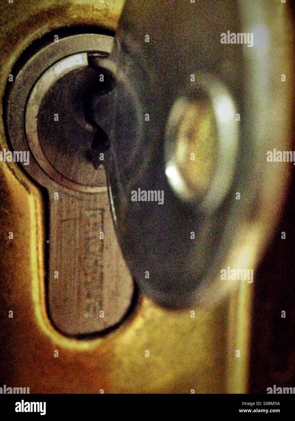 Unlocking the door - Stock Image