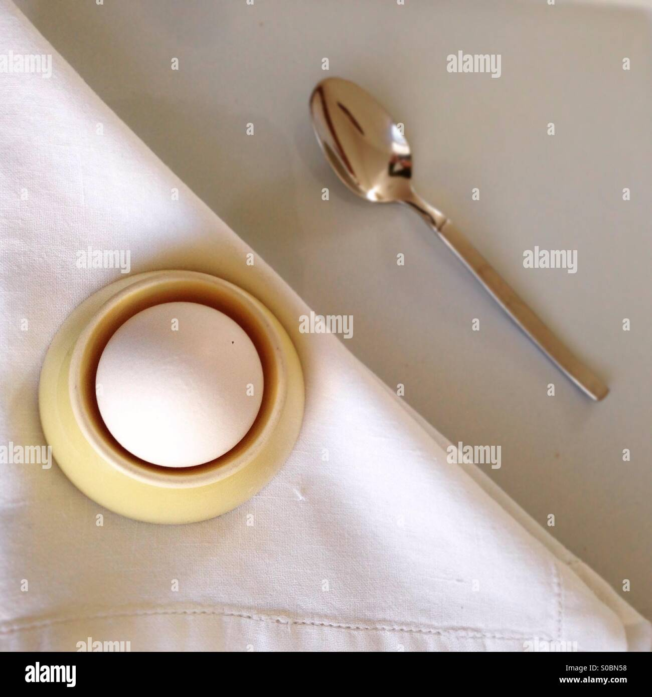 Boiled egg and spoon - Stock Image
