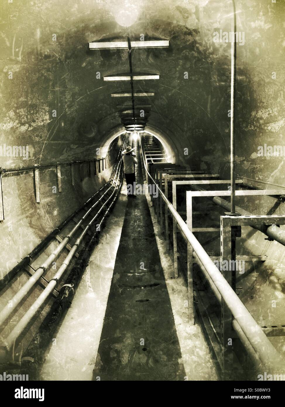 Person in air tunnel passage way - Stock Image