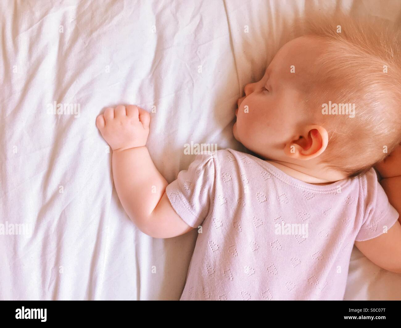 Sleeping baby - Stock Image