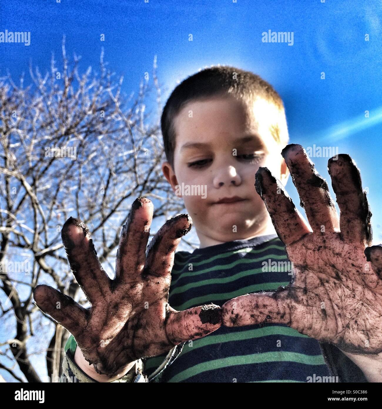 Mr. Muddy Hands - Stock Image
