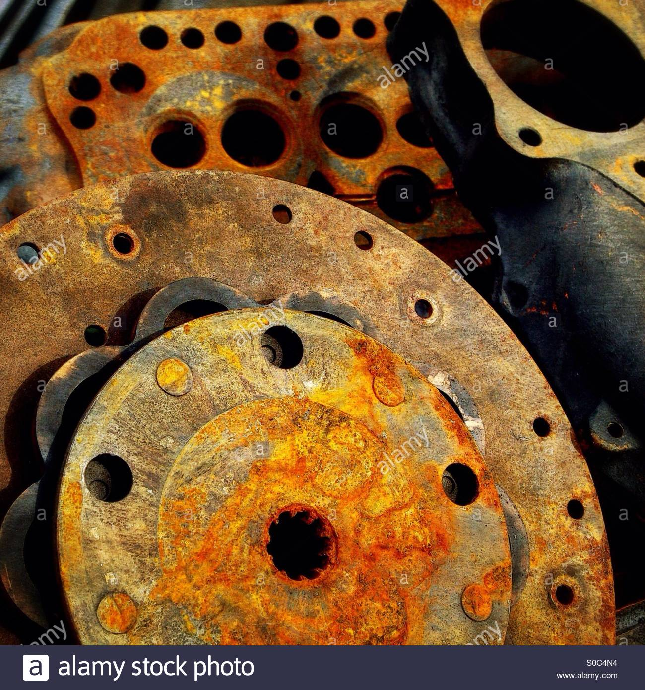 The future's orange; rusty engine parts in a boatbuilder's ...