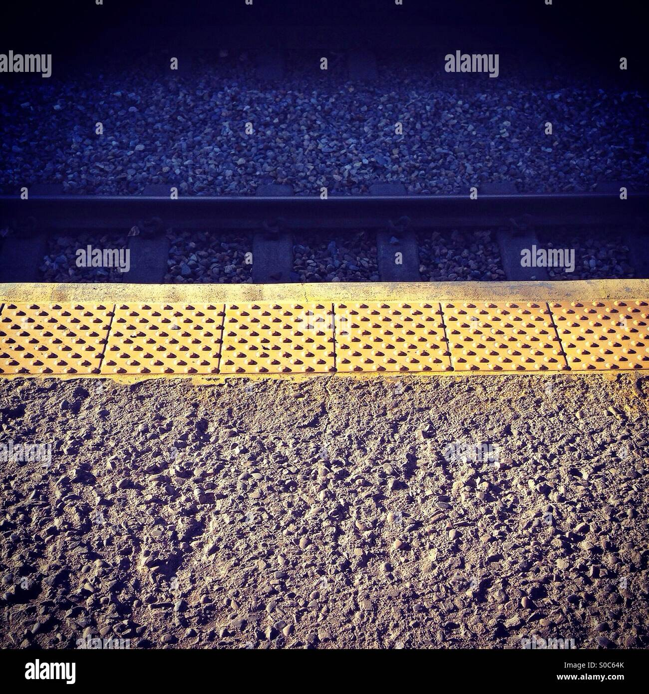On the platform, waiting for a train, in Calgary, Alberta, Canada. - Stock Image