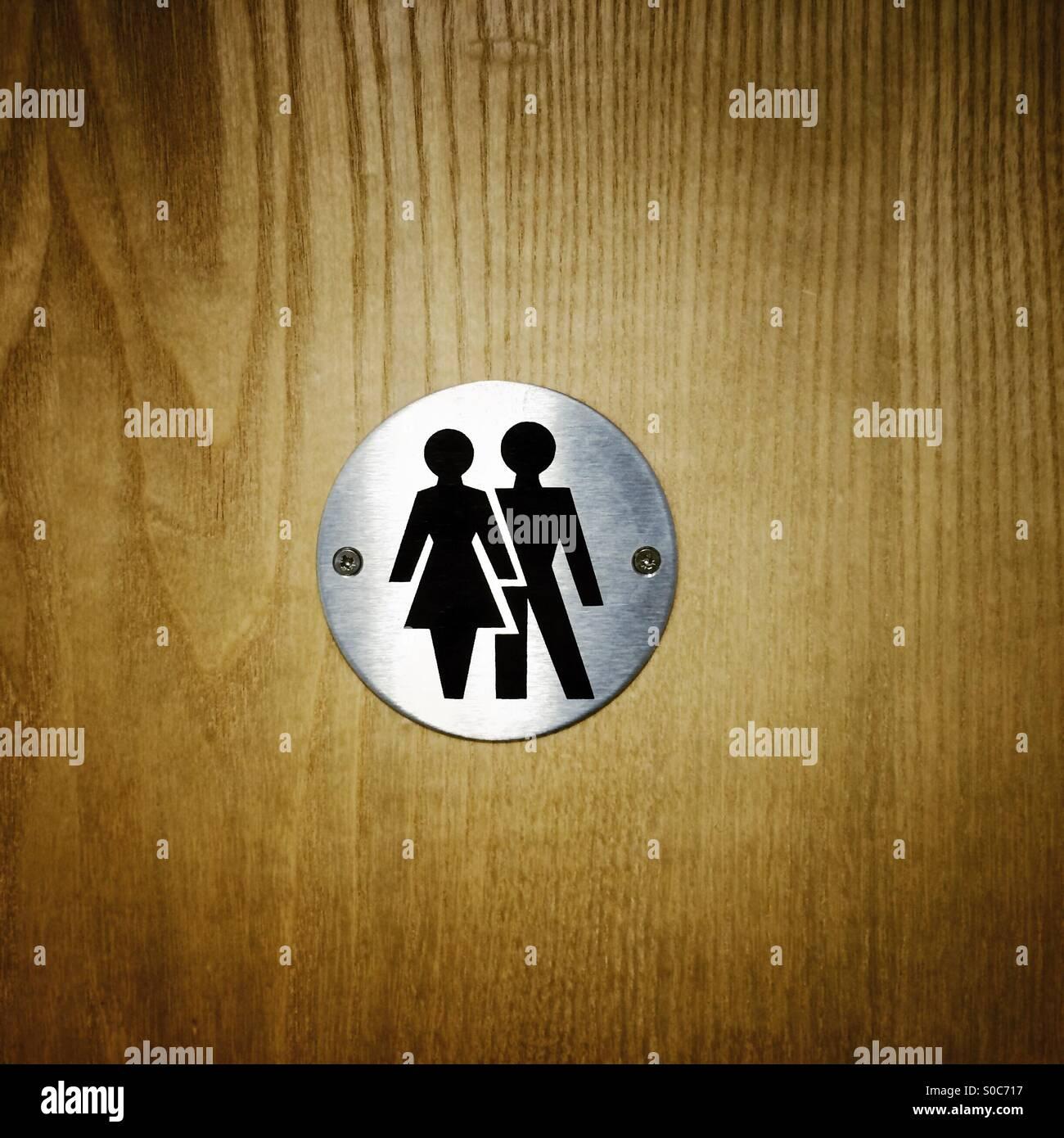 Male female men women couple unisex sign on wooden toilet wc door - Stock Image