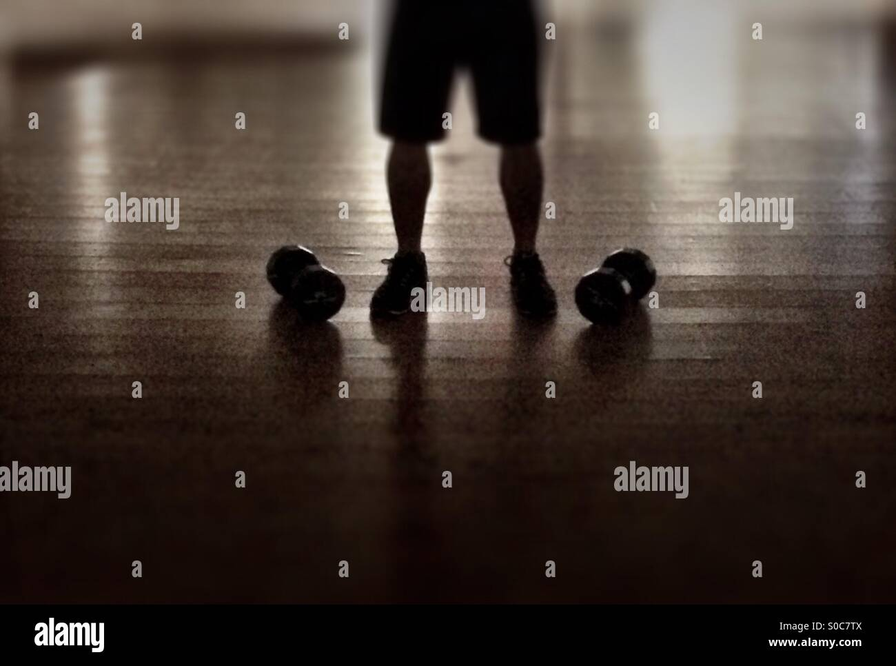 Man with barbells - Stock Image