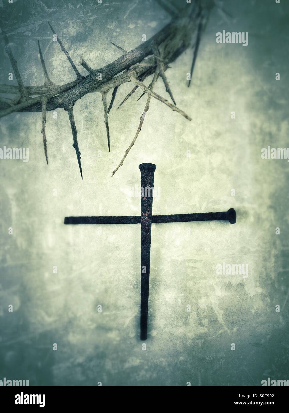 Crown of thorns with nails forming a cross. - Stock Image