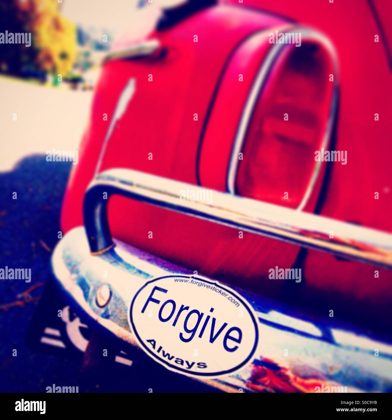 Forgive Always bumper sticker car Volvo - Stock Image