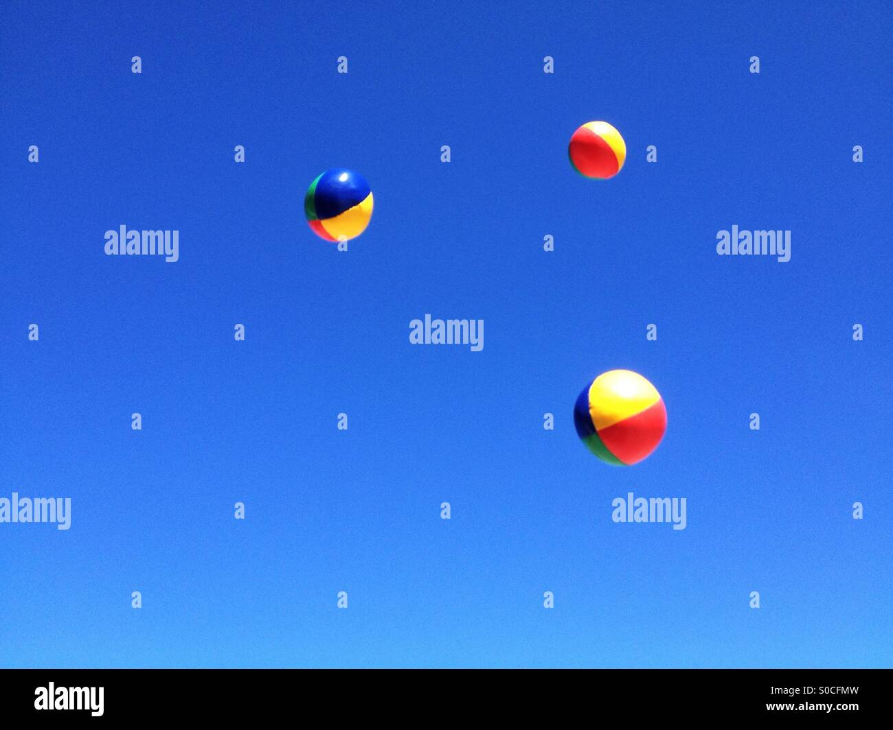 Juggling balls in the air - Stock Image