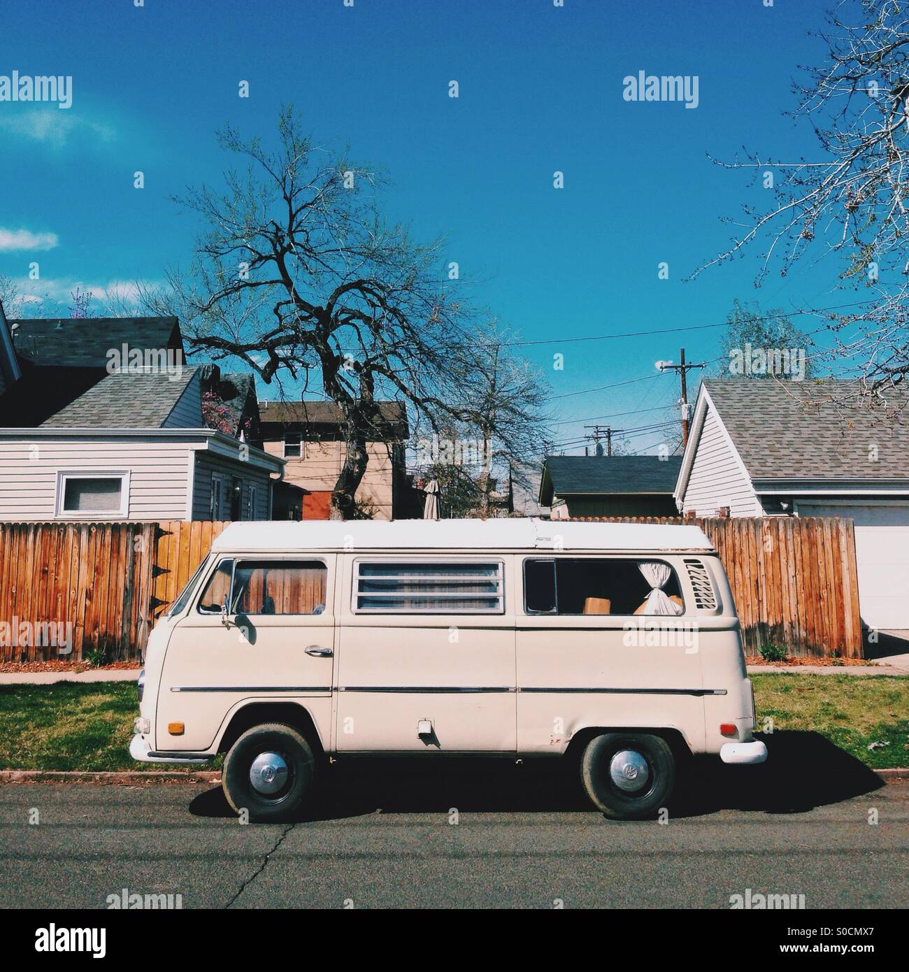 VW bus in the neighborhood - Stock Image