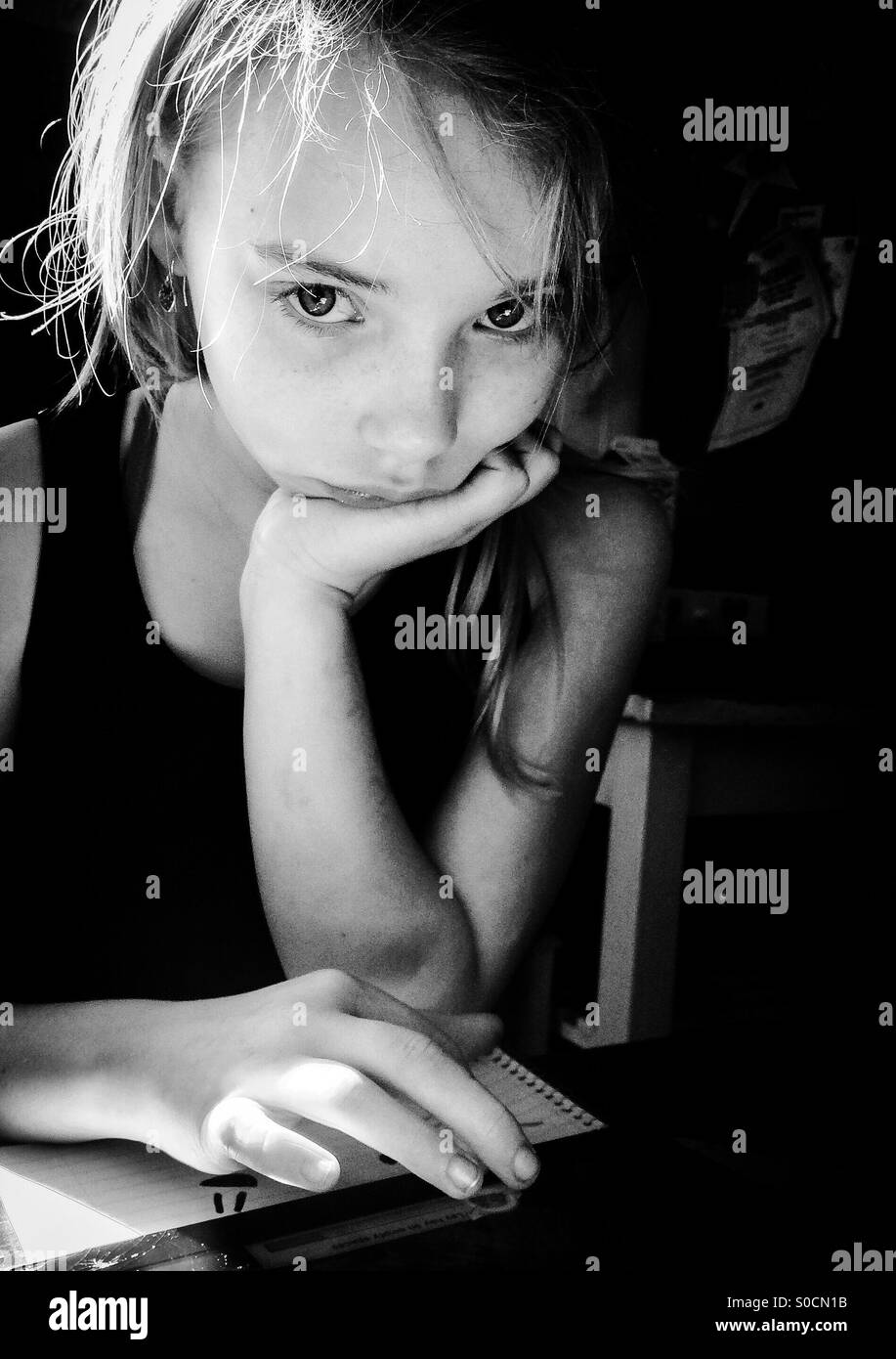 Girl with ipad and notebook - Stock Image