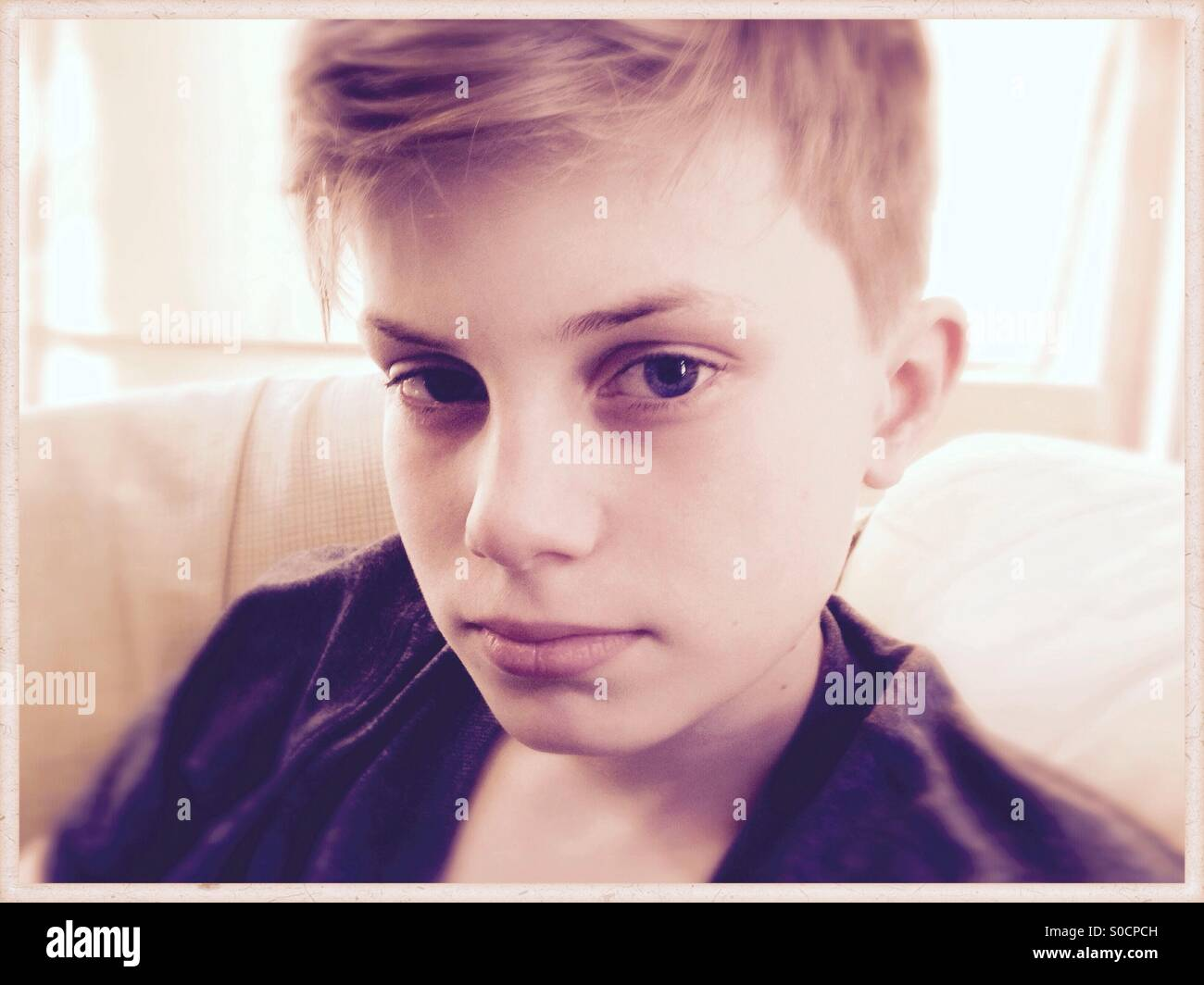 Portrait of a teen boy with serious look. - Stock Image