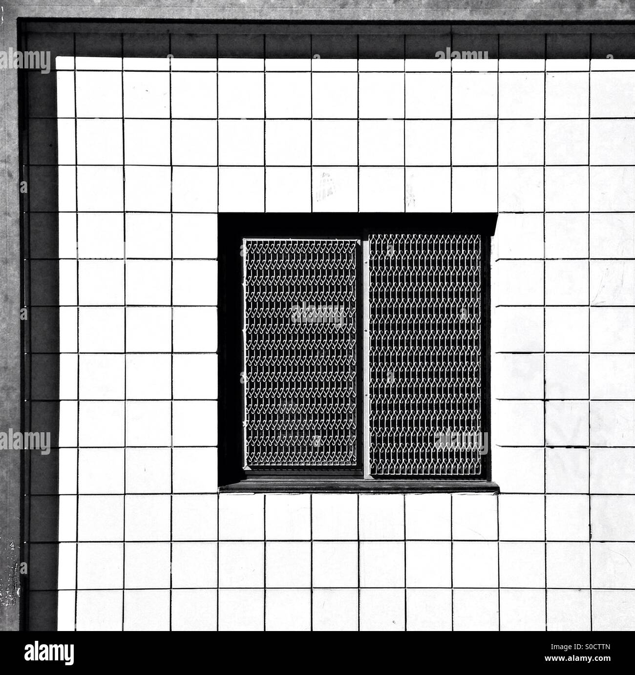 Abstract pattern of black and white squares and right-angles, taken from a section of a non-commercial building, - Stock Image