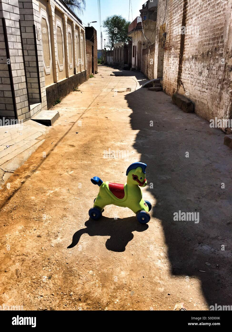 Forsaken horse toy in the street Kharian village Pakistan Asia - Stock Image