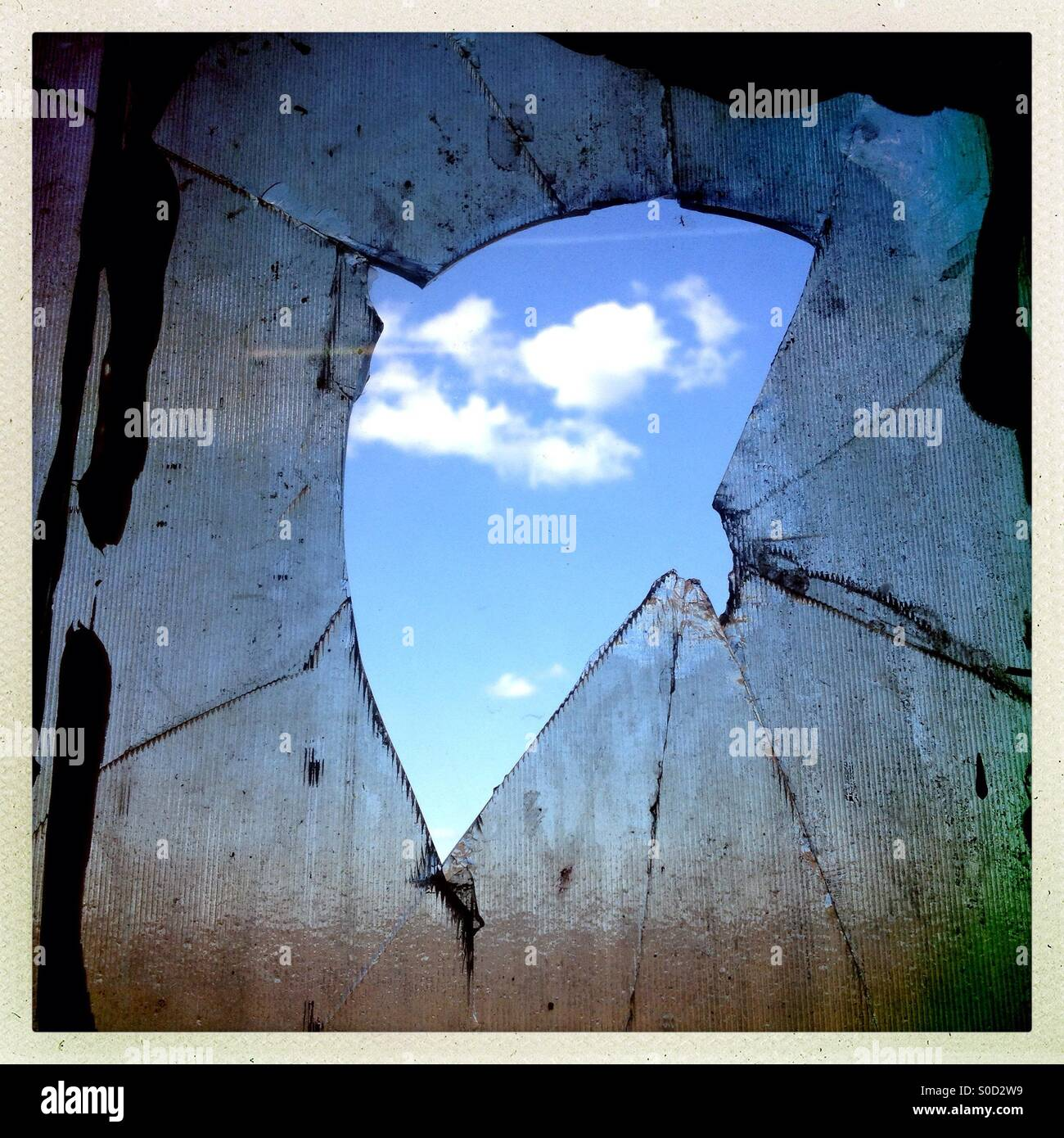 Sky through a broken window - Stock Image