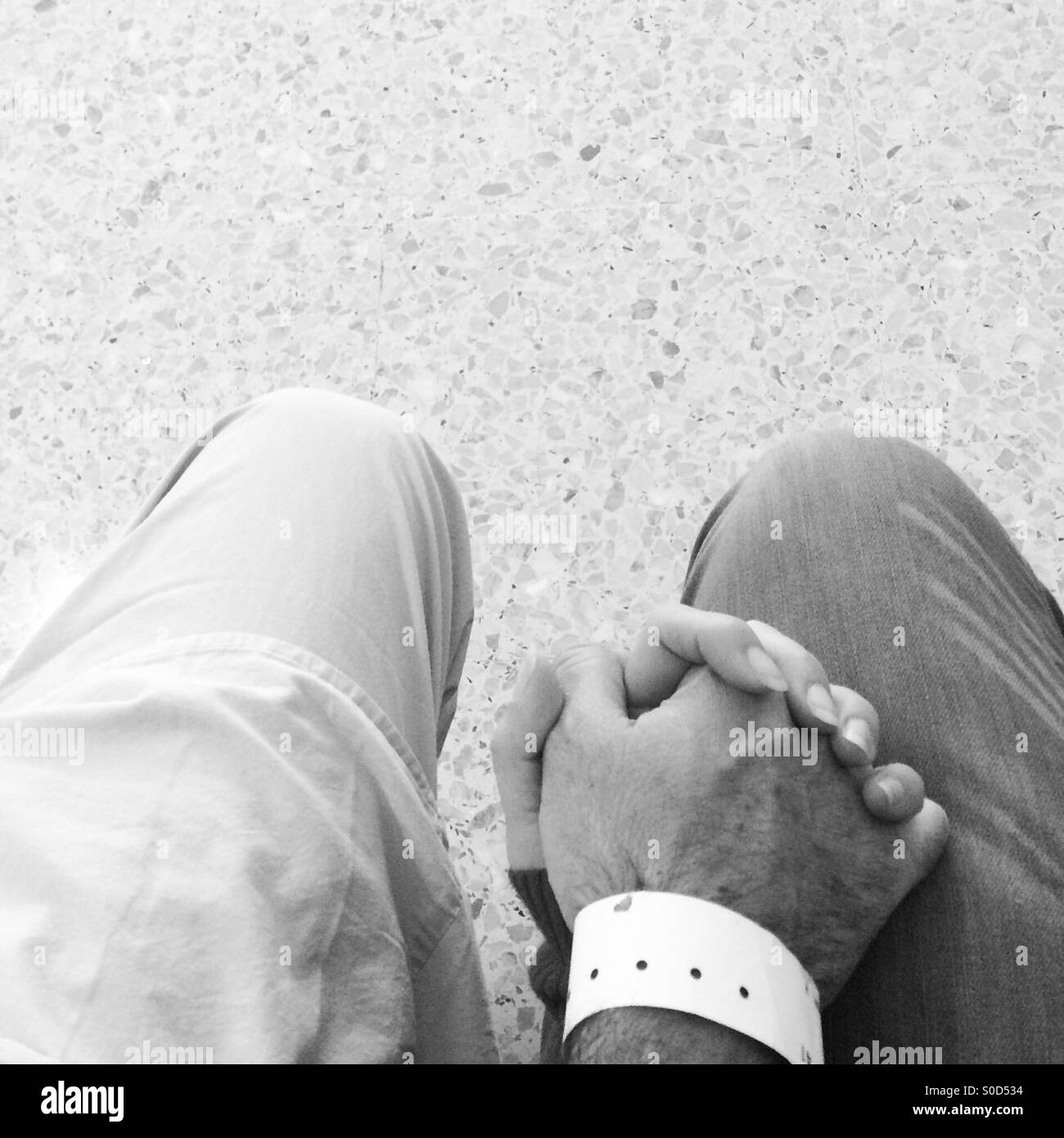 Holding hands at the hospital - Stock Image