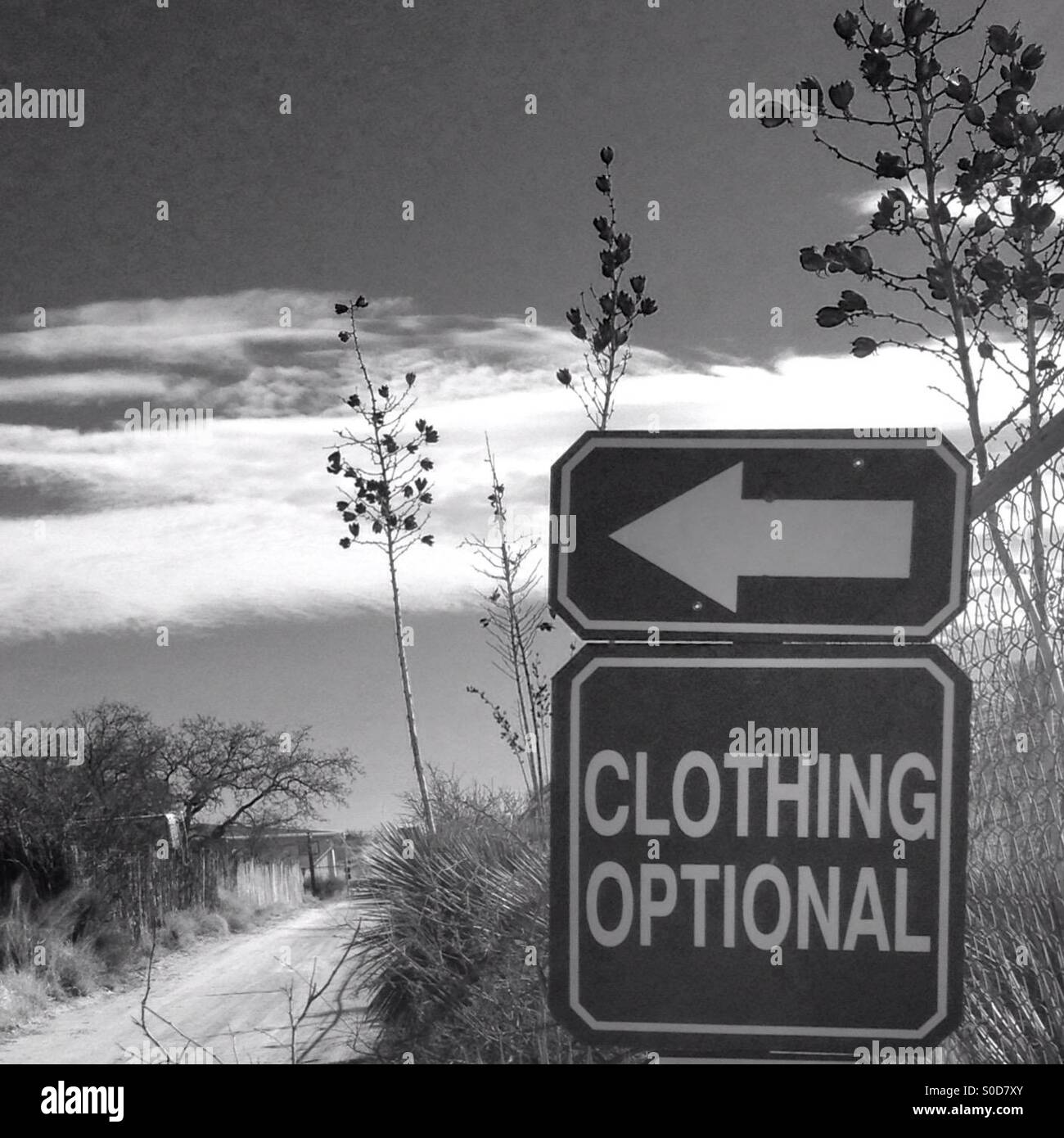 Clothing optional sign at hot springs - Stock Image